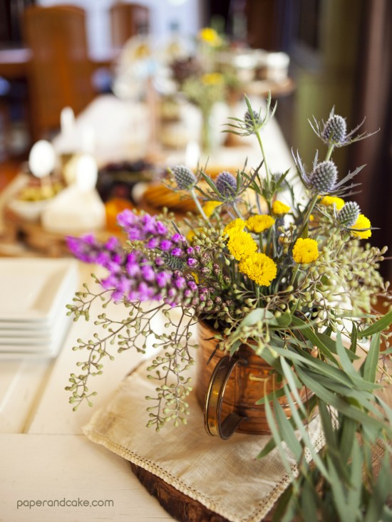 wine and cheese party table flowers